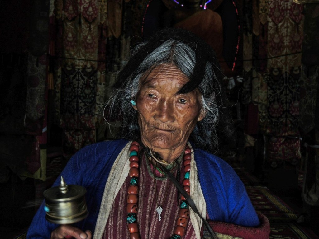 Monpa woman with a prayer wheel