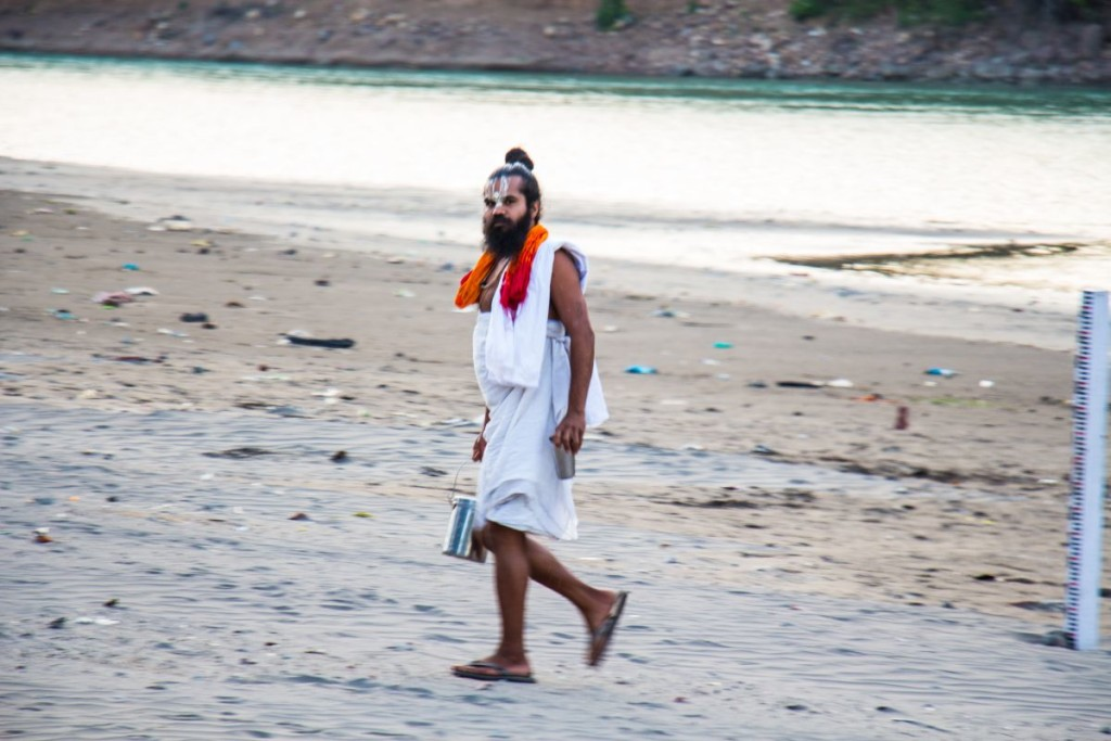 A sadhu walks on the banks of river ganga