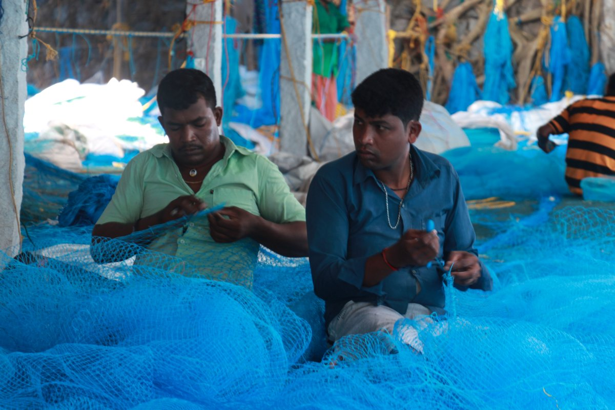 Fishermen mending their nets