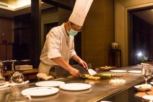 Chef at Fleur de Chine busy with Teppanyaki preparation