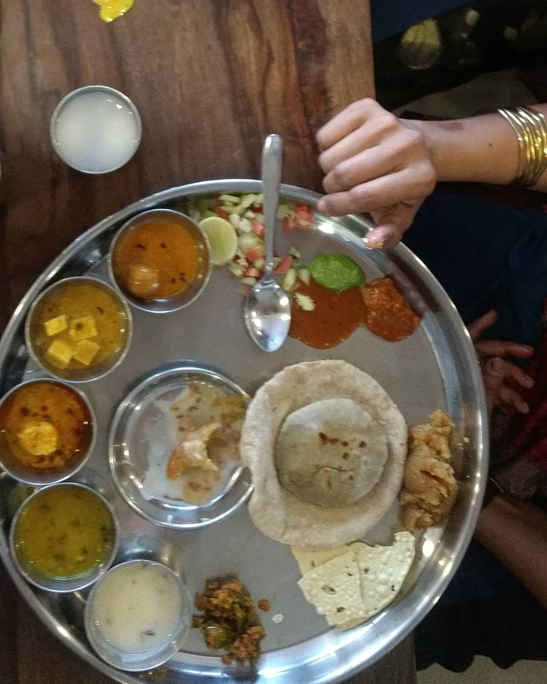 An Indian Thali or plate contains an assortment of dishesSabjiveggieshellip