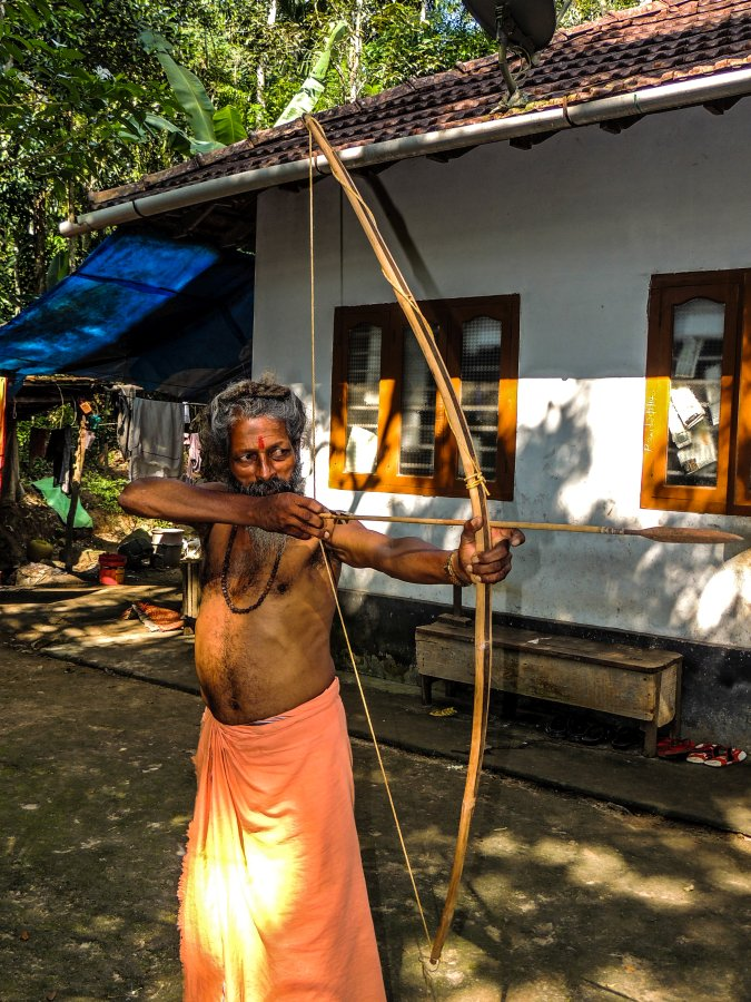 Govindan giving a demonstration of archery